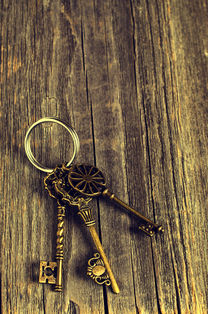 selective: Vintage metal key on a wooden background. Selective focus.