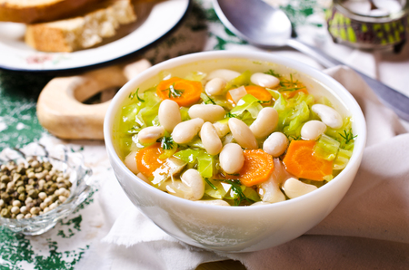 lima beans white beans: Soup with vegetables and beans in a dish. Selective focus. Stock Photo