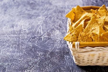 Mexican nachos chips of triangular shape. Selective focus. Archivio Fotografico