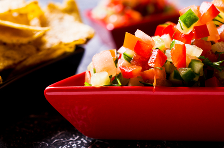 tortilla chips: Fresh homemade salsa with vegetables and chips nachos. Selective focus.
