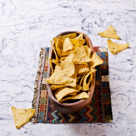 nacho chip: Mexican nachos chips of triangular shape. Selective focus. Stock Photo