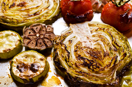 dripping pan: Grilled vegetable slices on a metal background. Selective focus. Stock Photo