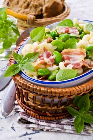 broad leaf: Pasta with bacon and vegetables in portion plate. Selective focus. Stock Photo