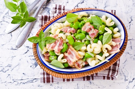 Pasta with bacon and vegetables in portion plate. Selective focus. Stock Photo