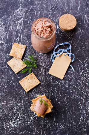 crisps: Liver pate with crisps on a dark background. Selective focus. Stock Photo