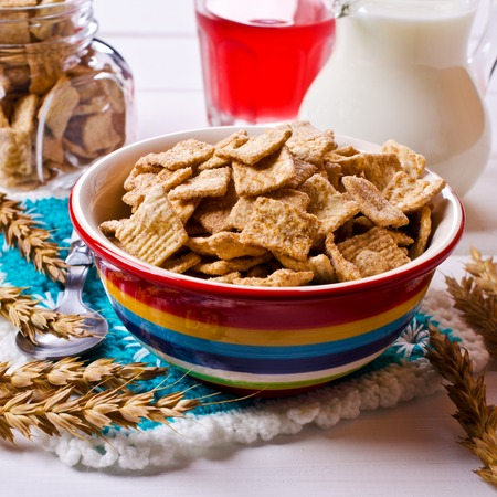Cereal flakes with cinnamon and sugar on a wooden background. Selective focus.