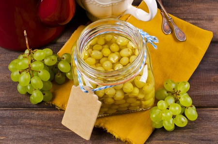concord grape: Jam of green grapes on a wooden background. Selective focus. Stock Photo