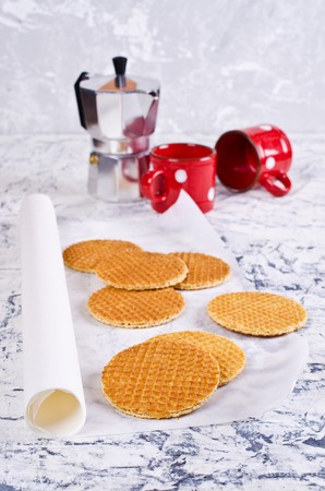 treacle: Traditional Dutch waffles on a light background. Selective focus. Stock Photo