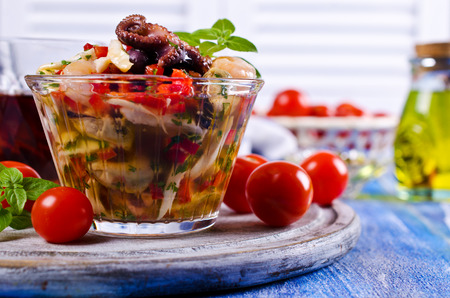 Seafood salad with vegetables and basil. Selective focus. Stock Photo