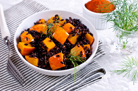butternut: Black rice with pumpkin. Selective focus. Stock Photo