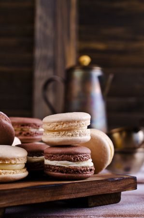 Brown and beige macaroon on a wooden background. Selective focus. Stock Photo