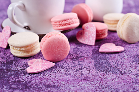 Homemade colorful macaroon with a light cream. Selective focus. Stock Photo
