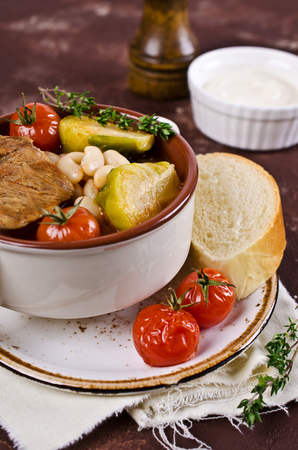 meat soup: Meat soup with beans and vegetables. Selective focus. Stock Photo