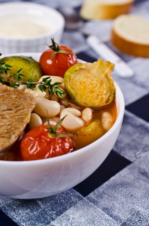 bean sprouts: Meat soup with beans and vegetables. Selective focus. Stock Photo