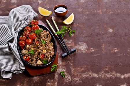 buckwheat noodle: Buckwheat noodles with vegetables in a spicy sauce. Selective focus.