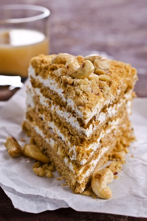 Layer cake with white cream and nuts. Selective focus. Stock Photo