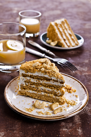 custard slice: Layer cake with white cream and nuts. Selective focus. Stock Photo