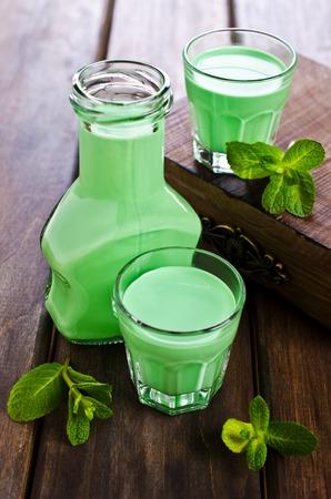 Green creamy liquid in a glass. Selective focus. Stock Photo