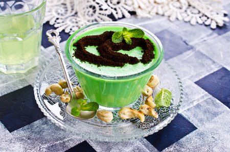 gelatina: Green panna cotta with mint and nuts. Selective focus.