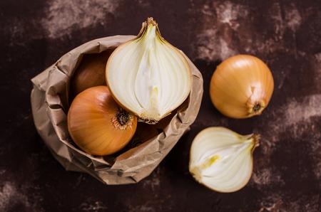 Fresh  bulb onions on the table. Selective focus.