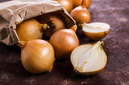 bulb fields: Fresh  bulb onions on the table. Selective focus.
