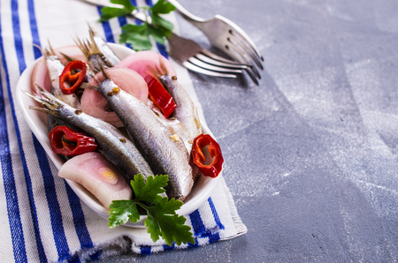 Small fish in brine with spices. Selective focus. Stock Photo