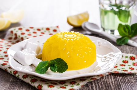 smooth: Traditional panna cotta with lemon and mint. Selective focus. Stock Photo