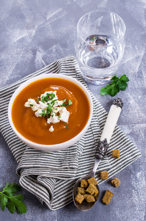 butternut: Dense vegetable soup with cream cheese and croutons. Selective focus. Stock Photo
