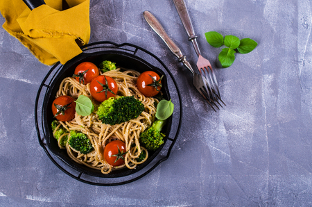 Wholegrain pasta with vegetables and cheese. Selective focus.
