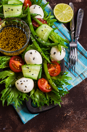 green bean: Salad of vegetables with mozzarella. Selective focus.