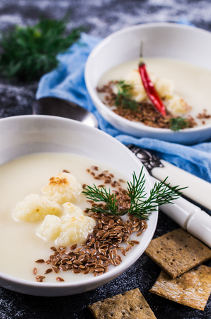 Creamy cauliflower soup with flax seeds. Selective focus. Stock Photo