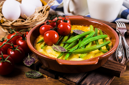 green bean: Omelette with vegetables in a serving bowl. Selective focus.