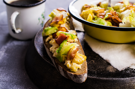 Sandwich with vegetables, bacon and scrambled eggs. Selective focus. Stock Photo