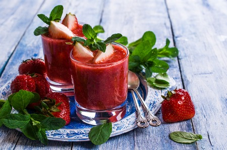 gazpacho: Cold strawberry soup with mint on a wooden background. Selective focus. Stock Photo