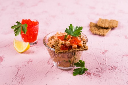 Pate of smoked salmon with caviar and parsley. Selective focus. Banco de Imagens