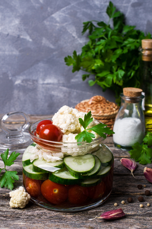 Assorted pickled vegetables with spices and parsley. Selective focus. Stock Photo