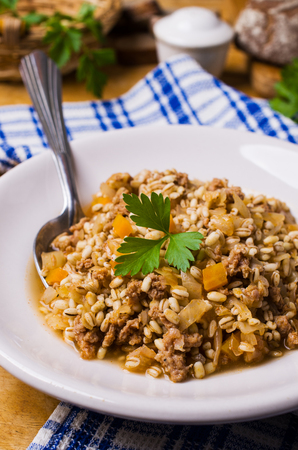 loose leaf: Pearl barley with vegetables and minced meat. Selective focus. Stock Photo