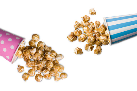 Popcorn with caramel taste on a white background. Selective focus.