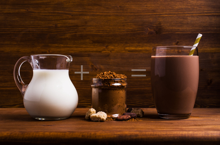 Traditional cocoa drink in glass on wooden background. Selective focus. Stock Photo