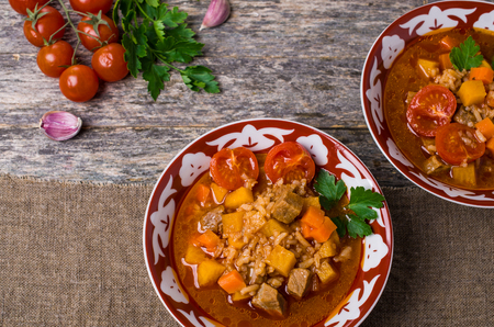 Thick soup with meat, rice and vegetables on wooden background. Selective focus. Archivio Fotografico - 100549594