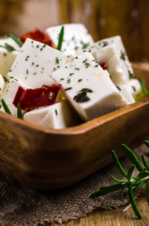 Traditional white cheese slices in oil with spices. Selective focus. Stok Fotoğraf