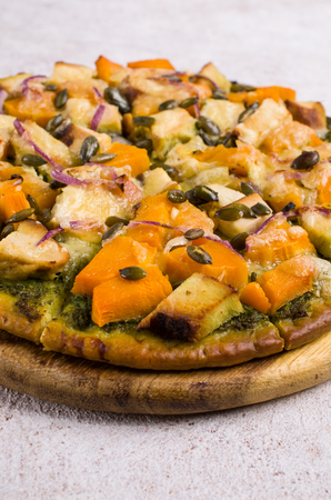 Pizza with vegetables and meat on a wooden Board. Selective focus. Reklamní fotografie