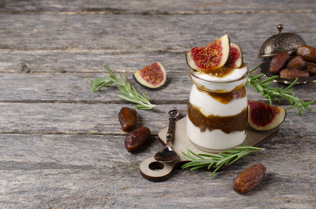 Traditional natural yogurt with jam in glass. Selective focus. Stock Photo