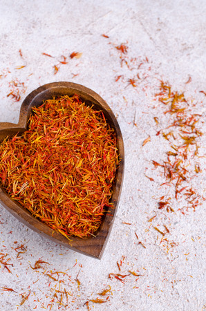 Traditional dry saffron spice on stone background. Selective focus. Standard-Bild
