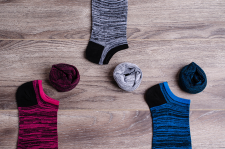 Short clean knitted socks on wooden background. Selective focus.