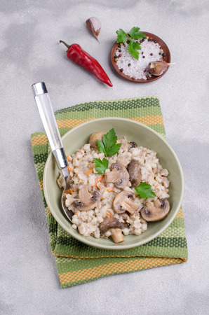 Traditional pearl barley porridge with vegetables and meat. Selective focus. Stock Photo