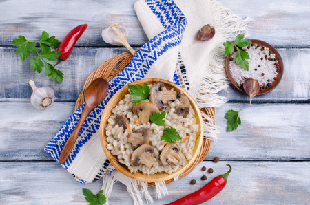Traditional pearl barley porridge with vegetables and meat. Selective focus. 스톡 콘텐츠