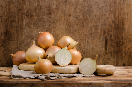 Large raw organic onions on wooden background. Selective focus. Stock fotó - 112375021