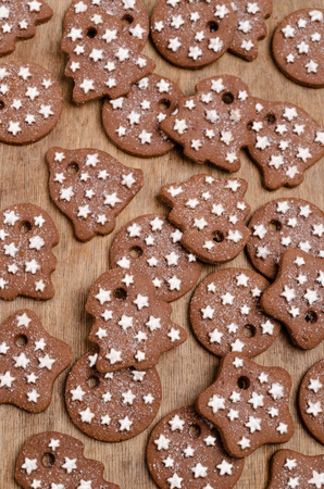 Traditional Christmas cookies with icing on wooden background. Selective focus.