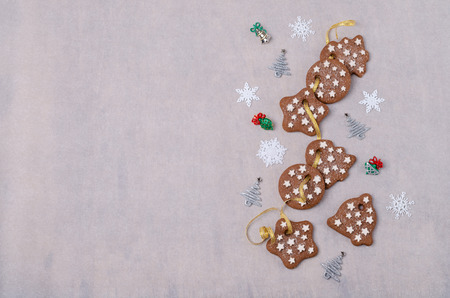 Traditional Christmas cookies with icing on paper. Selective focus.